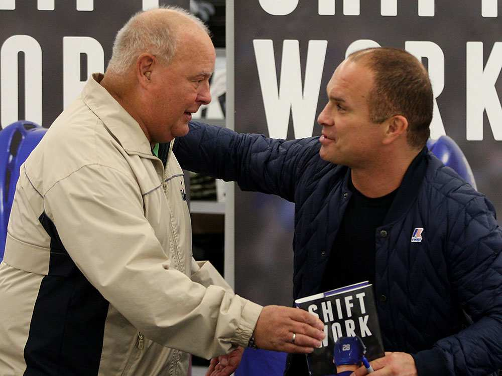 Tie Domi jumps off his chair to embrace his first hockey coach, Ed Soulliere, during a book signing event at WalMart on Dougall Road Wednesday November 11, 2015. The amiable Domi spent time with each fan, signing his book and chatting about the NHL and his early days in Belle River and the OHL. Soulliere coached Domi in Belle River and tells how Domi improved his skating each game and was named MVP of the team's yearend tournament. (NICK BRANCACCIO/Windsor Star)