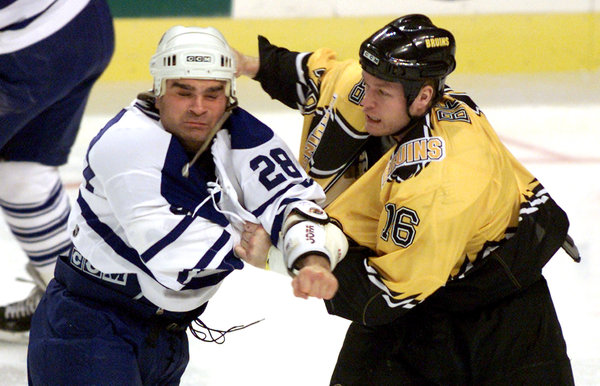 "Tie Domi, left, took on Ken Belanger in one of his 333 N.H.L. fights. ""The life of an enforcer is thankless,"" he wrote in his book ""Shift Work."" JIM BOURG / REUTERS"