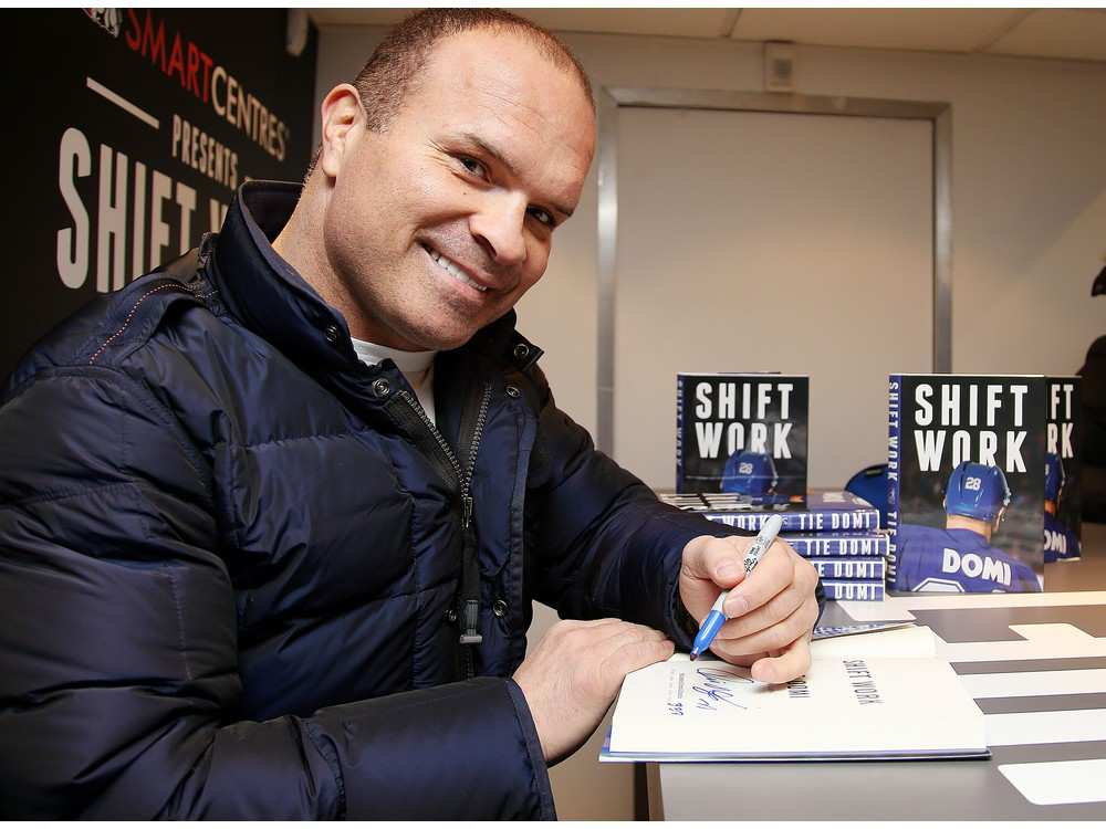 Toronto Maple Leafs legend Tie Domi signs his book Shift Work for fans while on a book tour.