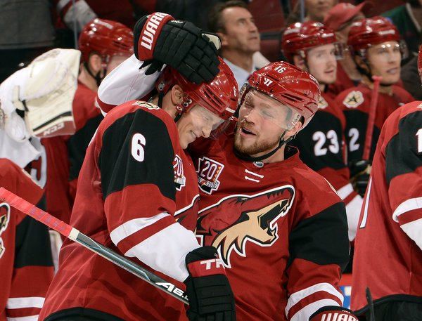 The Arizona Coyotes' Max Domi congratulating his teammate Jakob Chychrun (6) on Oct. 15 for recording his first N.H.L. point.